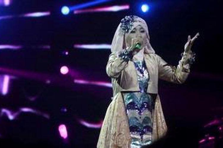 Satu dari dua peserta Grand Final X Factor Indonesia, Fatin Shidqia Lubis, tampil pada Result Show X Factor Indonesia, di Hall D JIExpo, Kemayoran, Jakarta Pusat, Jumat (24/5/2013) malam.