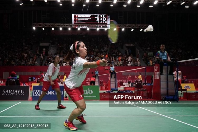 AKARTA, INDONESIA - OCTOBER 12: Oktila Leani Ratri/Sukohandoko Khalimatus Sadiyah of Indonesia in action against Cheng Hefang/Ma Huihui of China (not pictured) on the womens double SL3-SU5 final match at Istora Gelora Bung Karno in Jakarta, Indonesia on October 12, 2018. Indonesia wins gold medal over China 21-15, 21-12.