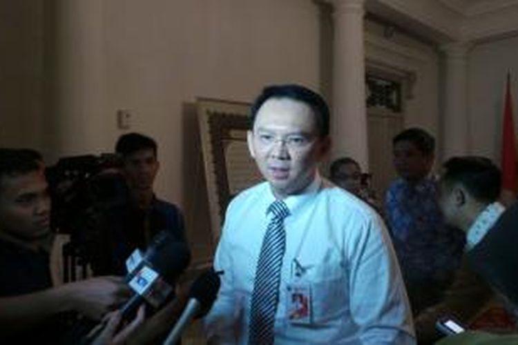 Wakil Gubernur DKI Jakarta Basuki Tjahaja Purnama seusai bertemu Gubernur DKI Jakarta Joko Widodo, di Balaikota Jakarta, Rabu (23/7/2014).