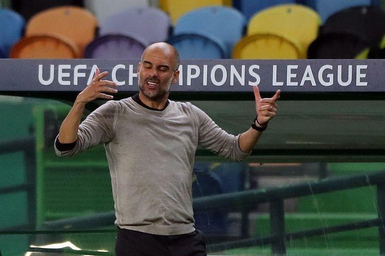 Reaksi Pep Guardiola pada laga perempat final Liga Champions, Manchester City vs Lyon, di Stadion Jose Alvalade, Lisbon, pada 15 Agustus 2020.