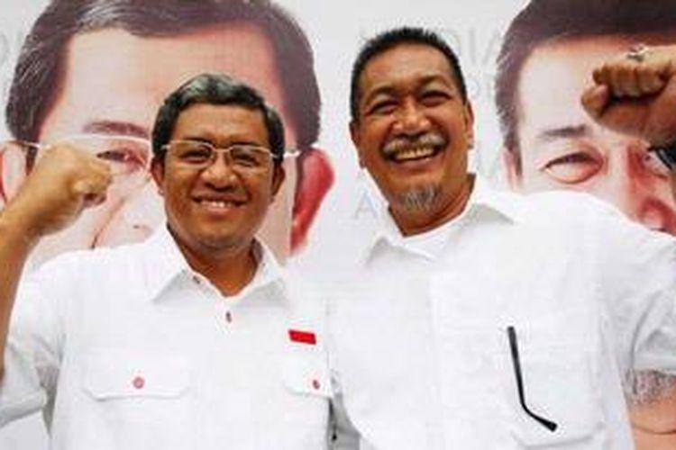 Gubernur Jawa Barat Ahmad Heryawan (kiri) dan Wakil Gubernur Jawa Barat Deddy Mizwar, sesaat setelah memenangkan Pemilu Gubernur Jawa Barat. Gambar diambil pada Minggu (3/3/2013).