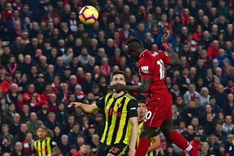 Sadio Mane mencetak gol dengan sundulan pada pertandingan Liverpool vs Watford di Stadion Anfield dalam lanjutan Liga Inggris, 27 Februari 2019.