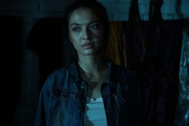 Artis peran Raline Shah saat perankan karakter Rian dalam film Police Evo.