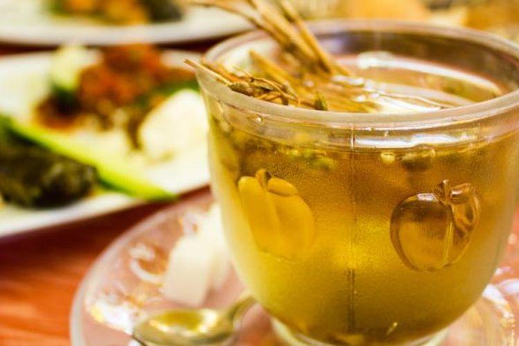 Ilustrasi secangkir teh.