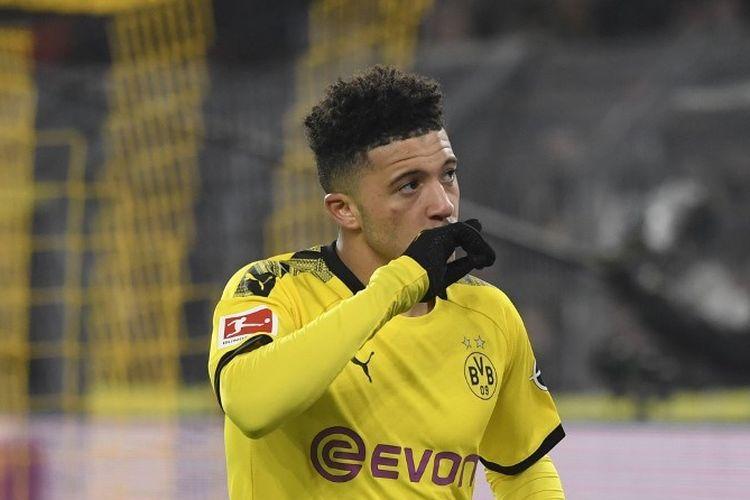 Jadon Sancho melakukan selebrasi seusai mencetak gol pada laga Borussia Dortmund v FC Cologne di Stadion Signal Iduna Park dalam lanjutan Bundesliga, kasta teratas Liga Jerman, 24 Januari 2020.