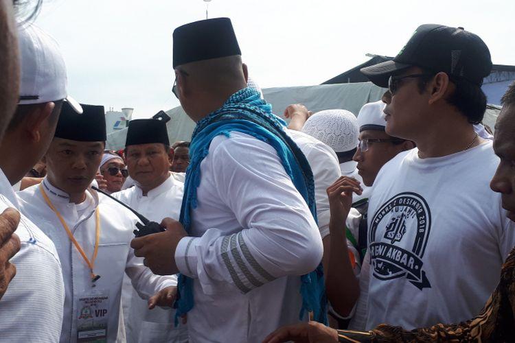 Prabowo Subianto saat meninggalkan acara reuni akbar 212 di kawasan Monumen Nasional, Minggu (2/12/2018).