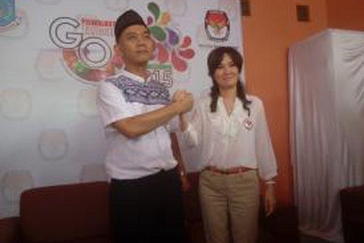 Ikhsan Modjo dan Li Claudia Chandra mendaftarkan diri sebagai calon wali kota dan wakil wali kota Tangerang Selatan di kantor KPU Tangsel, Senin (27/7/2015).