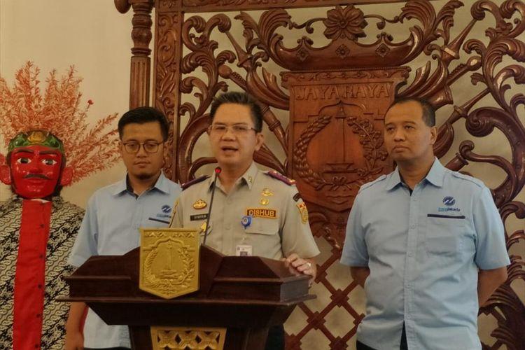 Kepala Dinas Perhubungan Syafrin Liputo (tengah) saat konferensi di Balairung, Balai Kota, Jakarta Pusat, Selasa (6/8/2019)