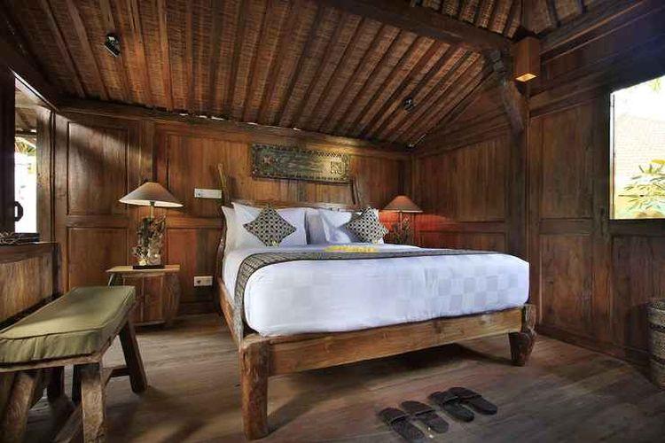 Salah satu kamar di penginapan Madani Antique Villas by EPS di Tegallalang, Bali.