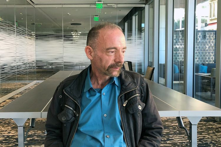 FILE - In this Monday, March 4, 2019 file photo, Timothy Ray Brown poses for a portrait in Seattle.  Brown, an American who was known for years as the Berlin patient, had a transplant in Germany from a donor with natural resistance to the AIDS virus. It was thought to have cured Browns leukemia and HIV. But in an interview Thursday, Sept. 24, 2020, Brown said his cancer returned last year and has spread widely. His case has inspired scientists to seek more practical ways to try to cure the disease.  (AP Photo/Manuel Valdes)