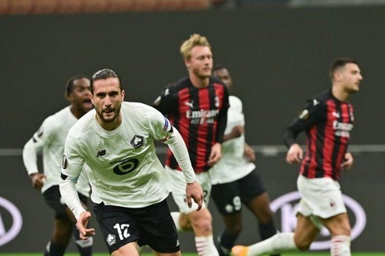 Gelandang sayap asal Turki, Yusuf Yazici, merayakan gol yang ia cetak dalam laga AC Milan vs Lille pada matchday ketiga Liga Europa 2020-2021 yang digelar di Stadion San Siro, Jumat (6/11/2020) dini hari WIB.