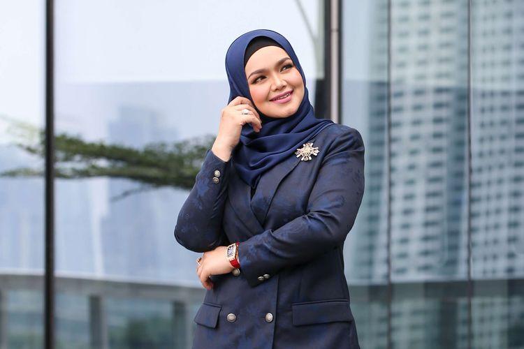 Penyanyi asal Malaysia, Siti Nurhaliza berkunjung ke Kantor Redaksi Kompas.com di Menara Kompas, Jakarta, Jumat (9/8/2019).