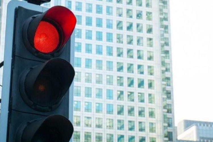 Ilustrasi lampu pengatur lalu lintas.