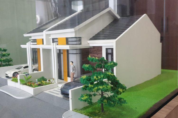 Ilustrasi miniatur rumah.