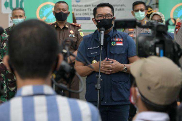 Gubernur Jawa Barat Ridwan Kamil saat menghadiri konferensi pers di Puskesmas Garuda, Kota Bandung, Senin (14/9/2020).