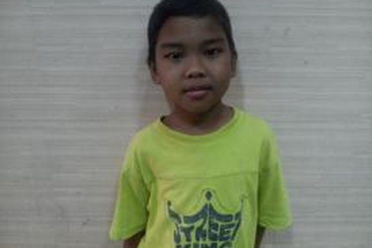Muhammad Afrizal (9) mencari ibunya selama sebulan dengan berjalan kaki.