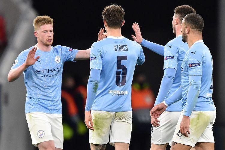 Skuad Manchester City merayakan kemenangan atas Borussia Moenchengladbach pada leg kedua 16 besar Liga Champions yang berlangsung di Puskas Arena, Rabu (17/3/2021) dini hari WIB.