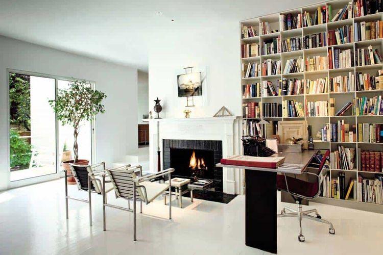 Konsep open plan yang menyatukan home-office dengan area bersantai dekat perapian