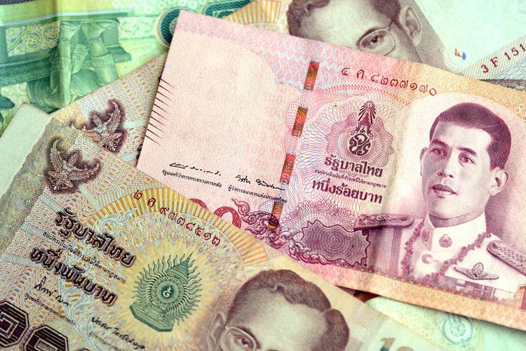 Ilustrasi uang baht Thailand.