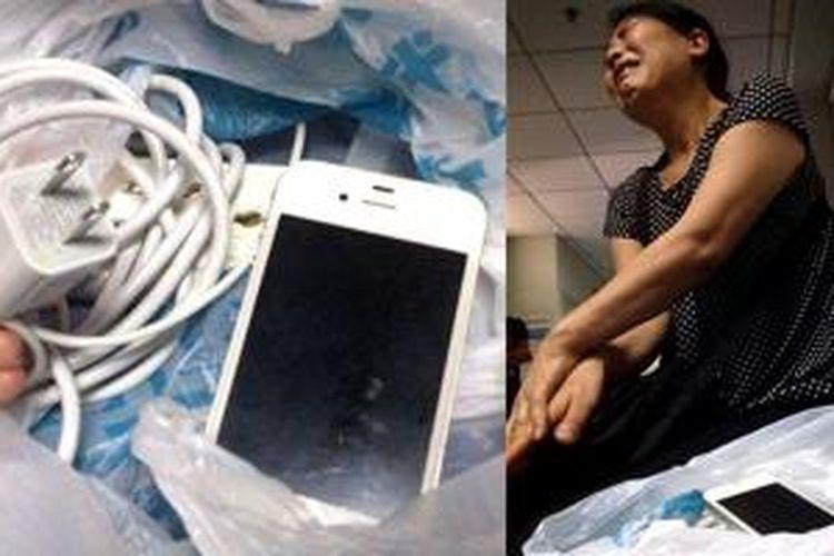 iPhone 4 dan charger milik Wu Jiantong.