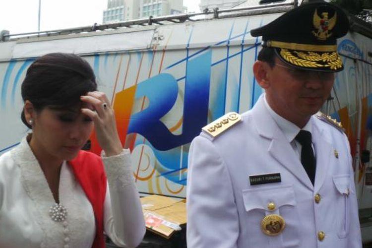 Basuki Tjahaja Purnama dan istrinya Veronica Tan di Istana Negara, Rabu (19/11/2014).