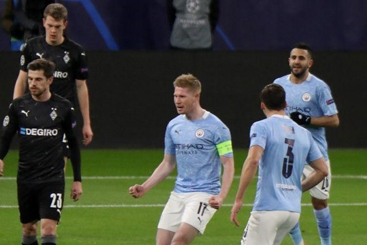 Pemain Manchester City Kevin De Bruyne berselebrasi seusai mencetak gol ke gawang Borussia Monchengladbach pada laga Liga Champions di Puskas Arena, Budapest, 16 Maret 2021. Laga Man City vs Monchengladbach berakhir dengan skor 0-2
