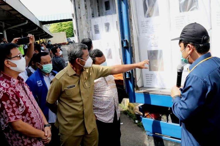 Agussyah menjelaskan, total 4.303 unit kotak suara yang didistribusikan ke 151 kelurahan se-Kota Medan dengan menggunakan truk box, Senin (7/12/2020)