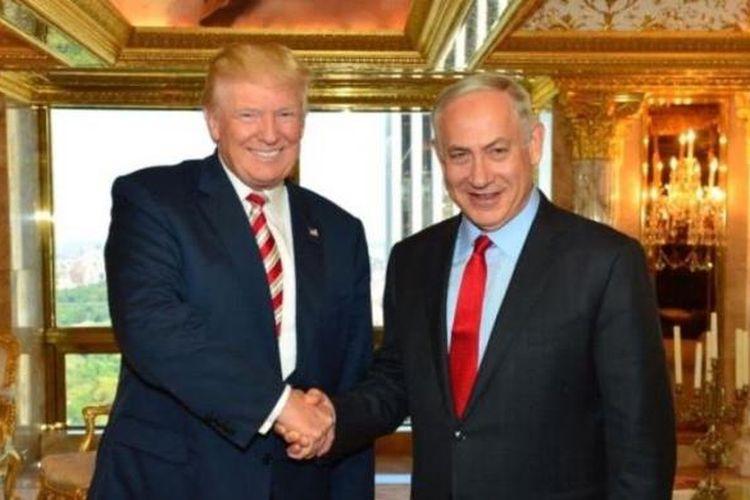 Presiden AS Donald Trump dan PM Israel Benjamin Netanyahu, dalam percakapan per telepon, Minggu (22/1/2017), membahas ancaman dari Iran dan perdamaian Israel-Palestina. Foto Ini diambil saat keduanya bertemu di Trump Tower, New York, pada 26 September 2016.