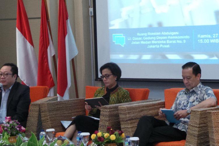 Menteri Keuangan Sri Mulyani dan Kepala Badan Koordinasi Penanaman Modal (BKPM) Thomas Trikasih Lembong, di diskusi Forum Merdeka Barat 9, Gedung Kemenkominfo, Jakarta Pusat, Kamis (27/7/2017).