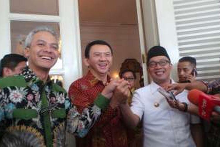 (kiri ke kanan) Gubernur Jawa Tengah Ganjar Pranowo, Gubernur DKI Jakarta Basuki Tjahaja Purnama, Wali Kota Bandung Ridwan Kamil seusai melakukan pertemuan di Balai Kota, Kamis (25/2/2016).