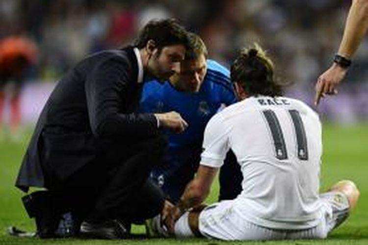 Gareth Bale mengalami cedera saat Real Madrid menang atas Shakhtar Donetsk, Selasa (15/9/2015).