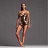 Celine Dion Pukau Penggemar dengan Bodysuit Futuristik Berwarna Emas