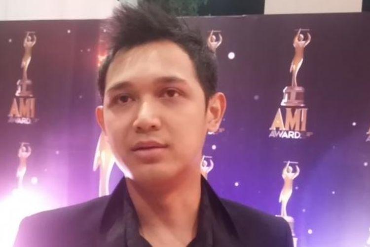 Bondan Prakoso diabadikan saat menghadiri malam puncak Anugerah Musik Indonesia (AMI) Awards 2015 di Econvention Ancol, Selasa (22/9/2015) malam.