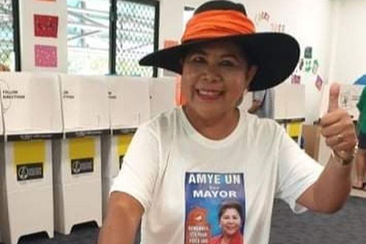 Amye Un, saat memberikan suaranya di pusat pemungutan suara Kota Darwin
