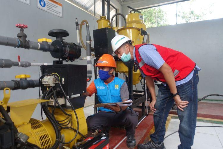 Mesin pembangkit listrik berbahan bakar pelet yang dibuat dari sampah rumah tangga di Pulau Tinggi, Bangka Selatan.