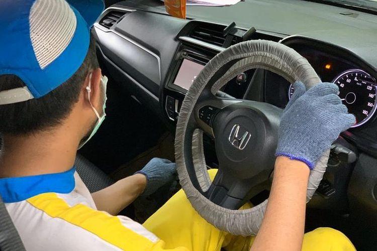 Ilustrasi servis mobil oleh Bengkel Resmi Honda