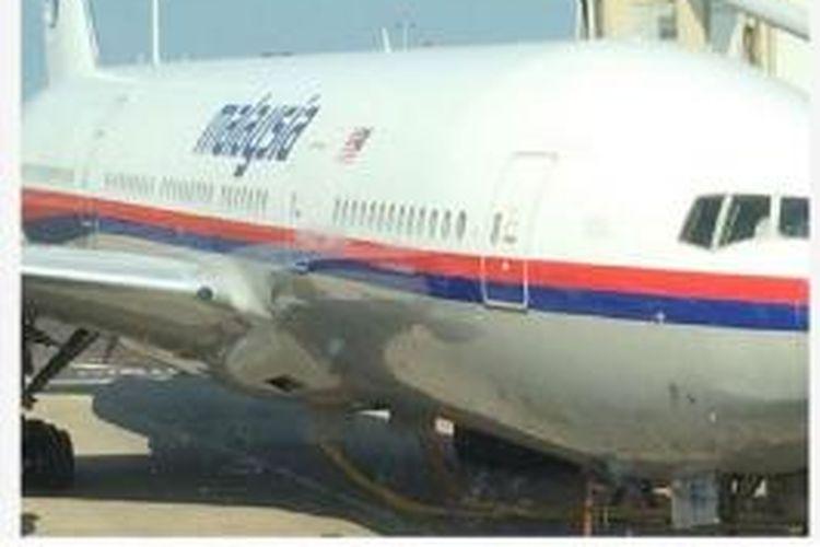 Foto pesawat Malaysia Airlines MH17 yang diunggah seorang turis Belanda di akun Facebook-nya beberapa saat sebelum ia naik ke pesawat yang nahas itu