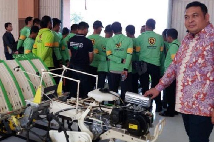 Kemampuan mesin transplanter setara 15 hingga 27 hari orang kerja