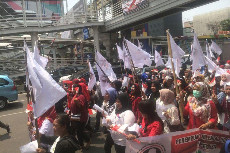 Organisasi Perempuan Milineal Indonesia (PERMISI) Saat unjuk rasa di depan Kantor BAWASLU RI, Jakarta, Rabu (12/9/2018).