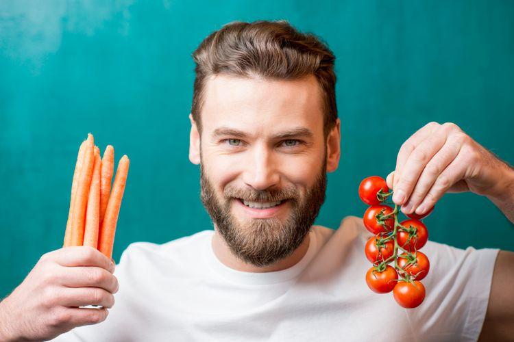 Ilustrasi pria makan tomat