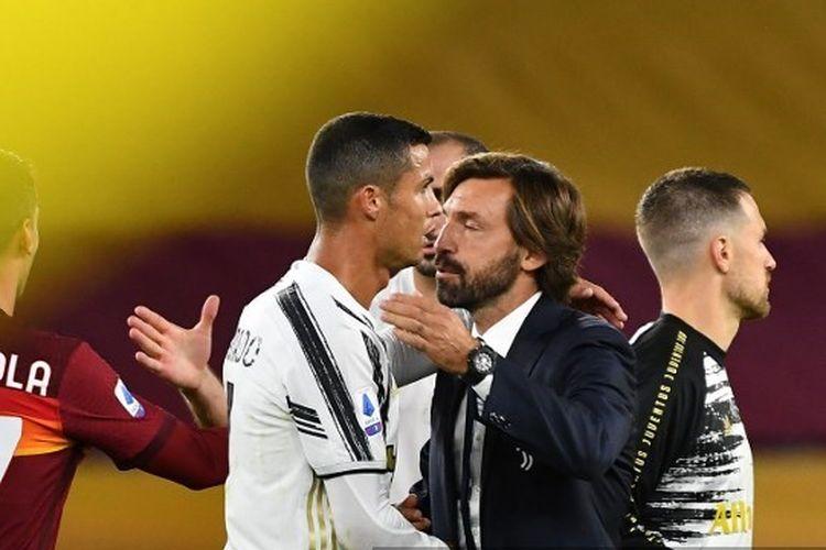 Cristiano Ronaldo dan Andrea Pirlo seusai laga AS Roma vs Juventus pada pekan kedua Liga Italia 2020-2021.