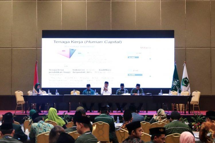 Menristekdikti saat menjadi narasumber Simposium Nasional Kebangsaan Ikatan Sarjana Nahdlatul Ulama (ISNU) di Jakarta (25/11/2018).