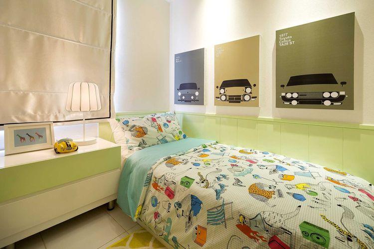 Kamar tidur anak nuansa warna hijau pada Kota Ayodhya Apartment Show Unit 3 Bedroom, karya: Teddykoo