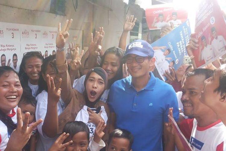 Calon wakil gubernur DKI Jakarta nomor pemilihan tiga Sandiaga Uno saat berkampanye di kampung Kebon Bayam, Kelurahan Papanggo, Tanjung Priok, Jakarta Utara, Rabu (25/1/2017)