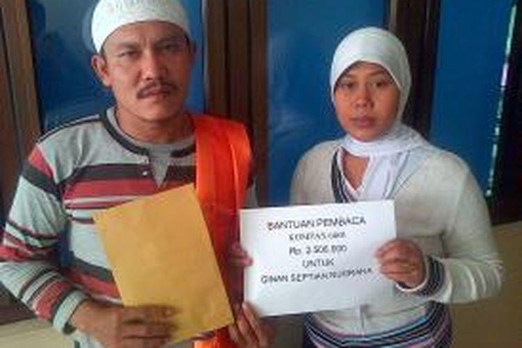 Aep Supriatna dan Yani Mulyani orangtua dari bayi kembar parasit Ginan Septian Nugraha kembali menerima bantuan dari pembaca kompas.com sebesar Rp. 2.500.000
