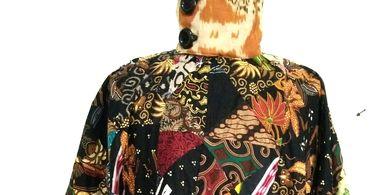 Konsep sustainable fashion yang diaplikasikan dengan memanfaatkan kain perca.
