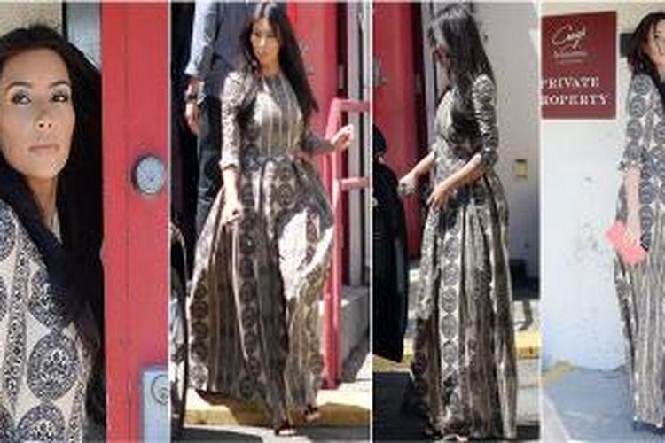 Gaun panjang Valentino untuk Kim buat geger karena gaya rancang yang sopan.