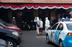 Polisi Jemput Paksa Warga yang Cium Jenazah Covid-19, Terancam Pidana