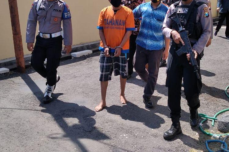 Tersangka Ho ditangkap setelah polisi melakukan penyelidikan.