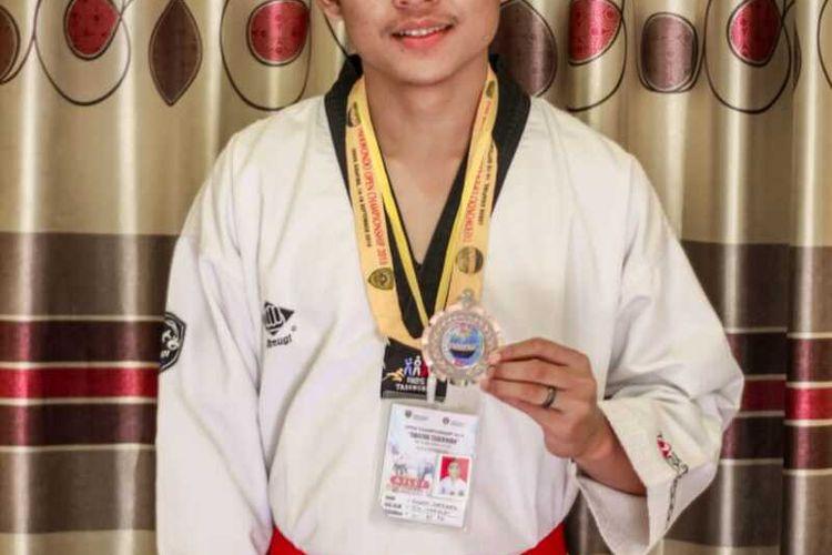 Thomas Hardianto saat meraih medali perunggu pada kompetisi taekwondo di Sumatera Barat tahun 2018 lalu.